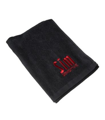 Sim rätik tikitud logoga